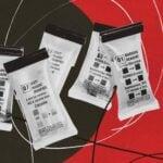Drug test kit pods collaged onto a red backdrop.