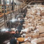 Package handlers sort through boxes while working at the FedEx Express World Hub in December 2014.