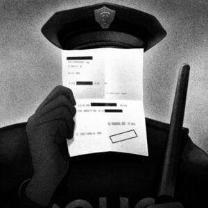 A police officer wielding a baton but hiding and shielding his face with a sheet of paper with legislation on it.