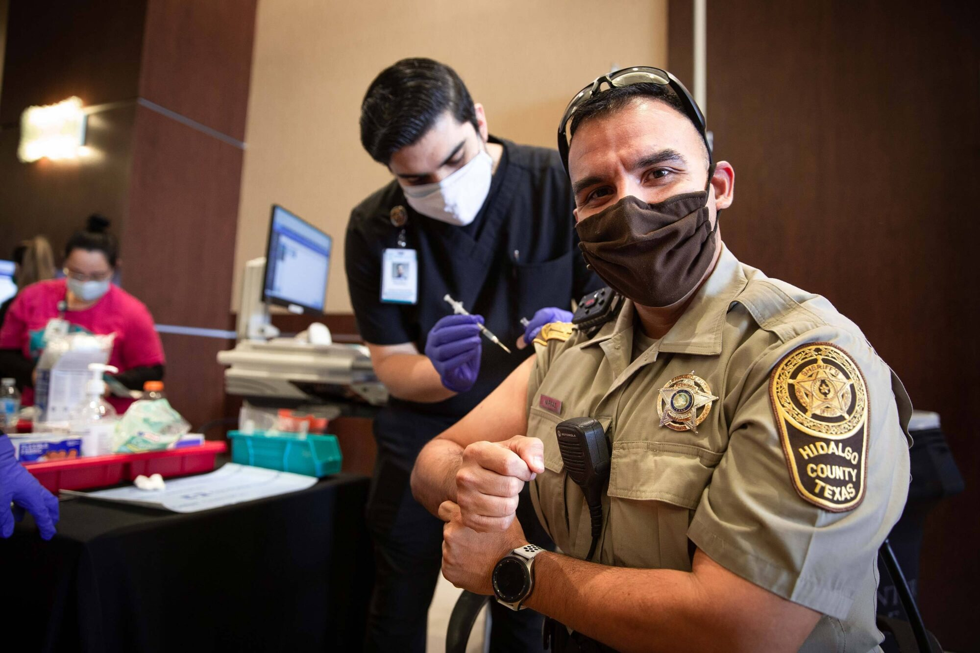 Senior Patrol Deputy Tony Vargas of Hidalgo County Sheriff's Office receiving a vaccination at the conference center on Saturday.