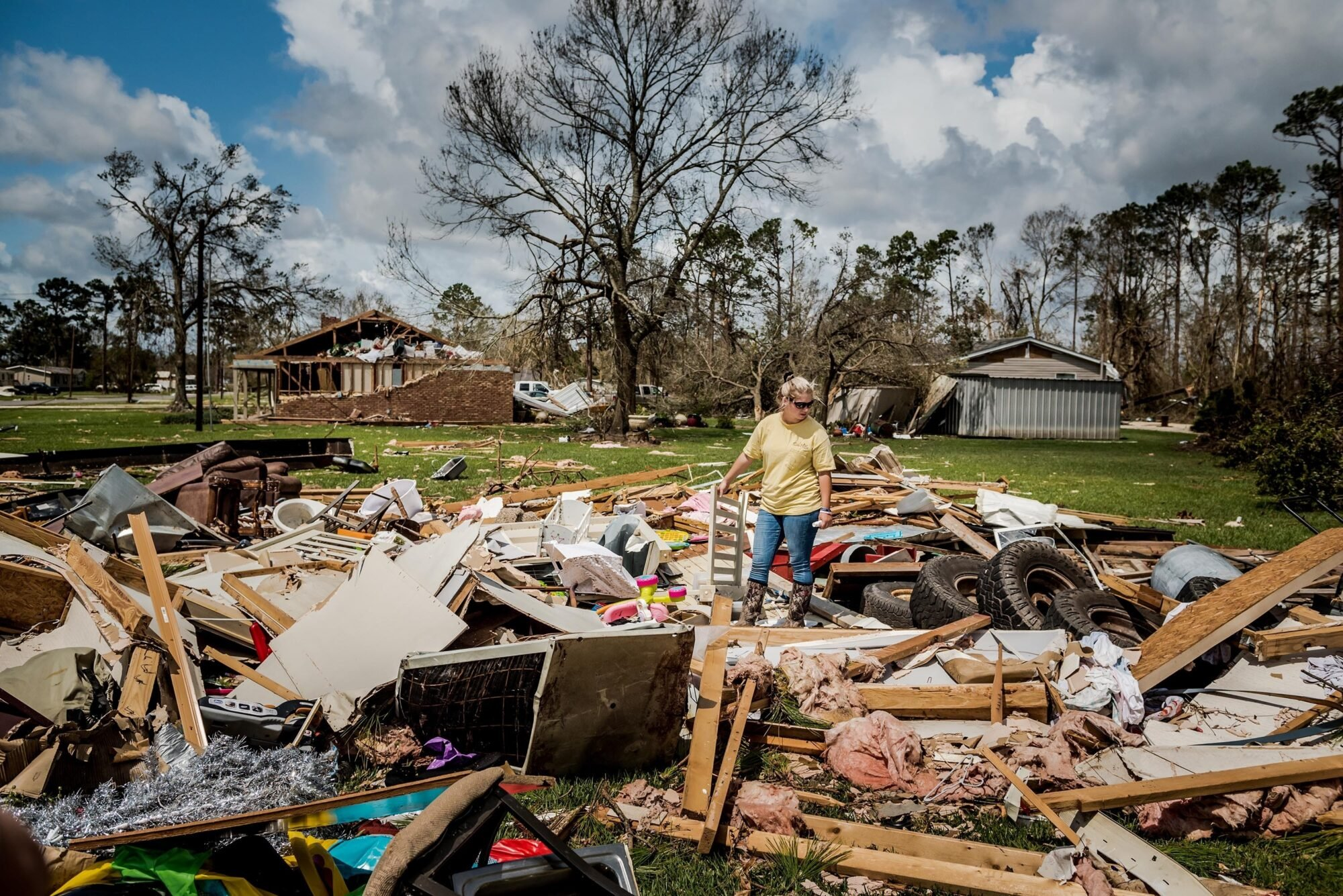 Cassidy Plaisance surveying what was left of her friend's home in Lake Charles, Louisiana, after Hurricane Laura.