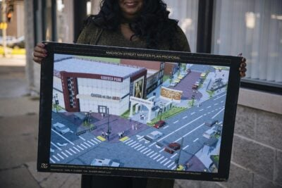 Siri Hibbler holding a plan for East Garfield Park.