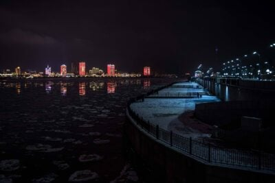 Towers in Heihe, China, illuminated in red across the Amur River from Blagoveshchensk. Chinese have settled throughout Siberia and the Russian Far East.