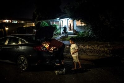 Erika González and her son, Kevin, evacuating their home in Sonoma County, California, as the LNU Lightning Complex Fire approached in August.