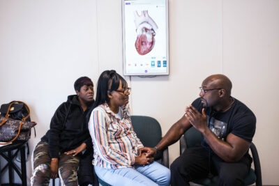 Dr. Foluso Fakorede speaks with a patient.