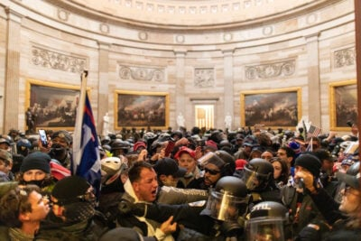 Police intervene as supporters of President Donald Trump breach security and enter the Capitol on Wednesday.