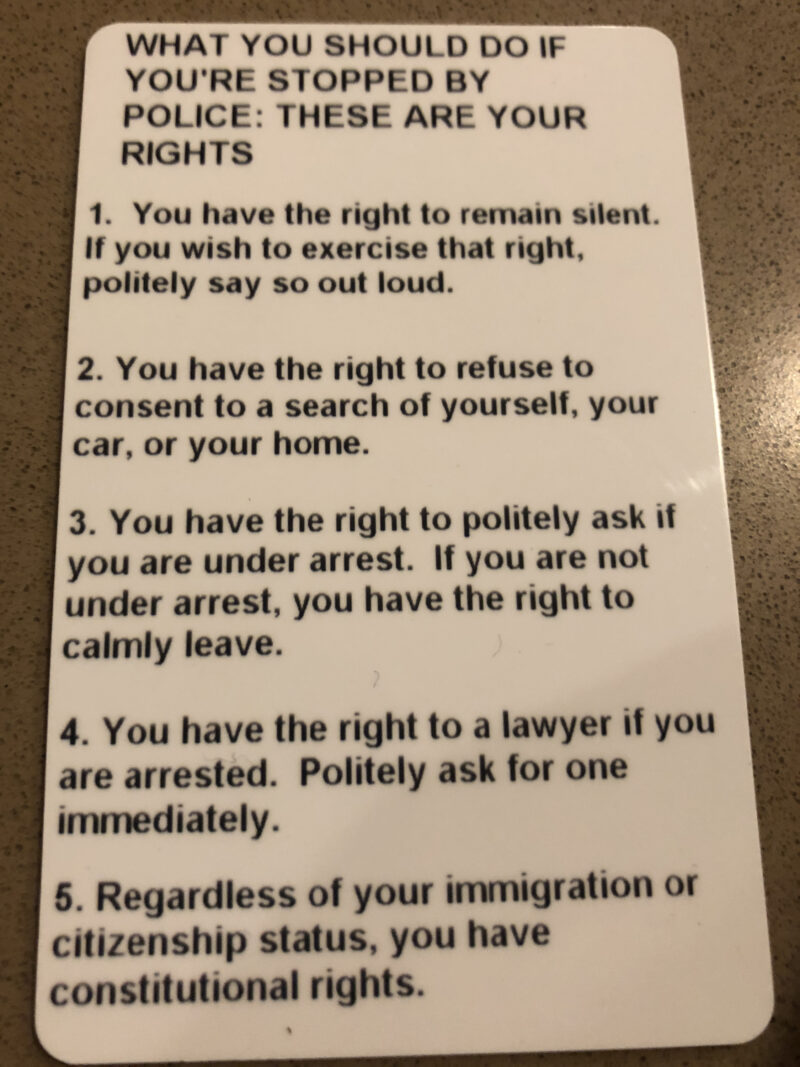Instructions on what to do when stopped by the police are on the back of student IDs at Summit Academy in Red Hook, Brooklyn. (Eric Umansky/ProPublica)