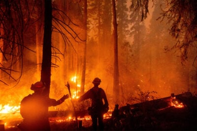 Firefighters battle the Creek Fire in the Shaver Lake community of Fresno County, California, on Sept. 7.